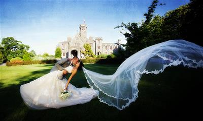 View Photo - Bride and groom kissing