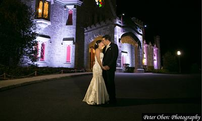 View Photo - Groom kissing bride