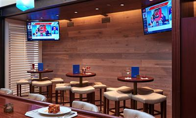View Photo #22 - Bar tables and television screens