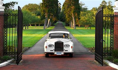 View Photo - Classic white car pulling into Bourne Mansion