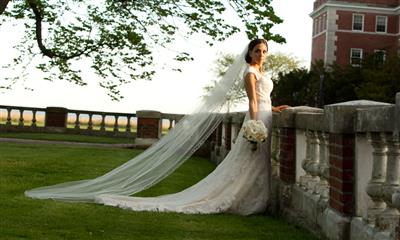 View Photo - Beautiful bride standing outside