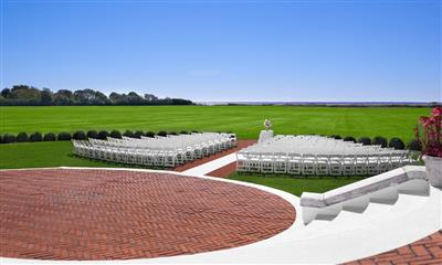 View Photo - Magnificent view of lawn wedding ceremony