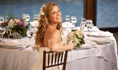 View Photo #8 - Beautiful bride sitting at wedding table