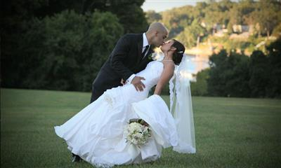 View Photo #23 - Groom kissing bride