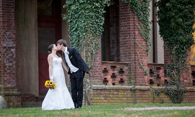 View Photo - Groom kissing outside of Chateau