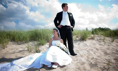 View Photo - Bride and groom on the beach
