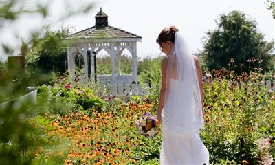 View Photo #18 - Bride by gazebo by the garden