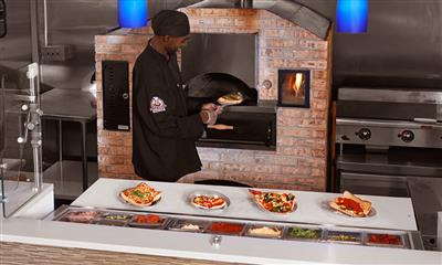 View Photo - Chef pulling pizza out the oven