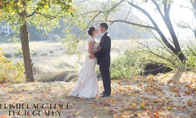 View Photo - Bride and groom sharing a loving embrace