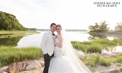 View Photo - Bride and groom by the harbor