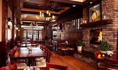 View Photo - Fireplace and restaurant dining area