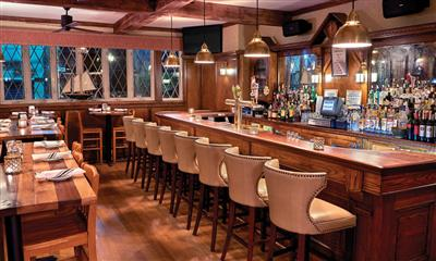 View Photo #1 - Bar and dining area