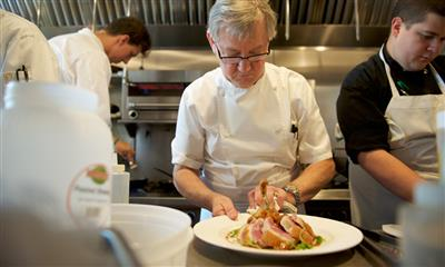 View Photo - Chef Guy Reuge preparing a dish