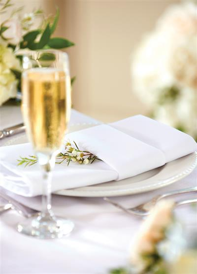 View Photo - Champagne alongside plate setting