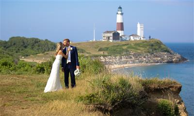 View Photo #10 - Wedding couple kissing in front of Montauk Lighthouse