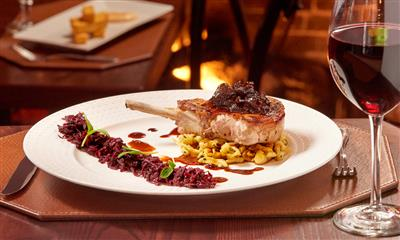 View Photo #8 - Pork Dish with a Glass of Red Wine