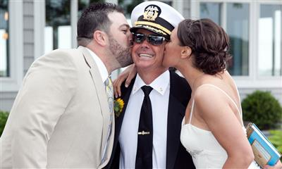 View Photo #6 - Bride and groom kissing captain