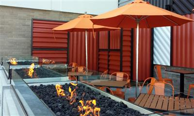 View Photo #2 - Blaze outdoor table seating along fire lit coal