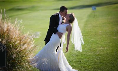 View Photo #12 - Groom kissing bride