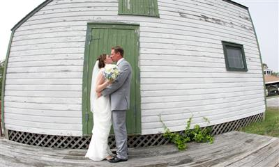 View Photo #11 - Groom and bride kissing