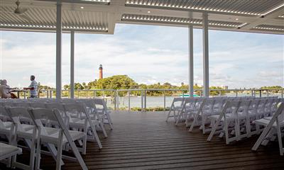 View Photo #17 - Chairs Set Up For Ceremony on Patio Overlooking the Lighthouse