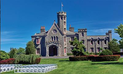 View Photo #1 - View of the Castle from the Front Lawn with Chairs Set Up For a Wedding