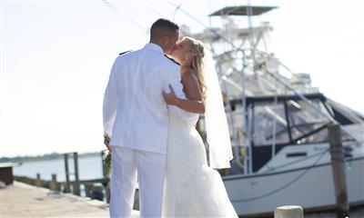 View Photo #6 - Couple Kissing With Boat in Background