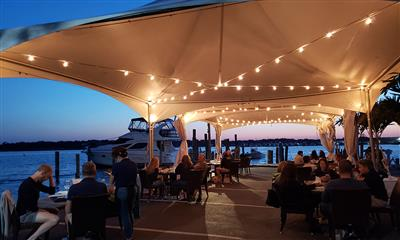 View Photo #1 - Outdoor Dining Under the Tent at Dusk